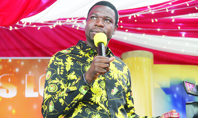prophet-walter-magaya-holds-a-sample-of-the-new-annointing-oil-as-he-introduces-into-to-thousands-of-his-congregation-during-their-big-sunday-service-yesterday-copy